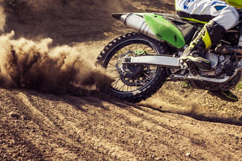 Dirt Bike Rider Turning on Track