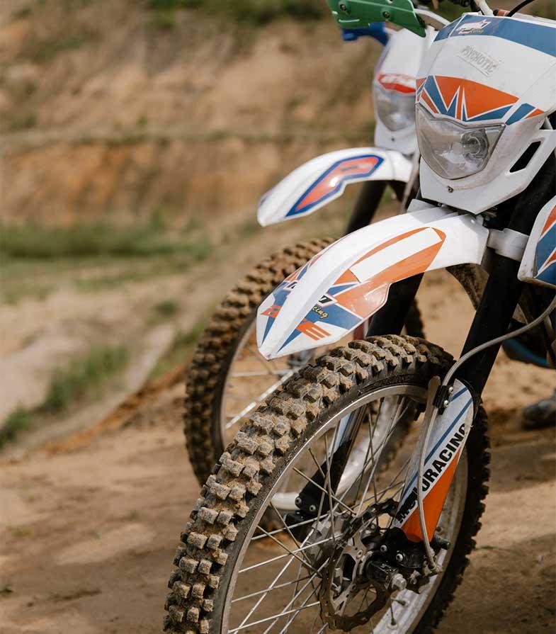Motocross Dirt Bikes Parked on Hill
