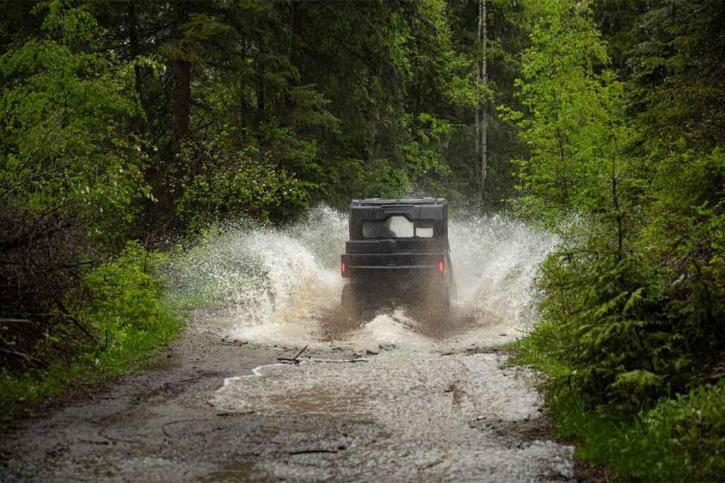 Off-Roading UTV Splashing Through Water