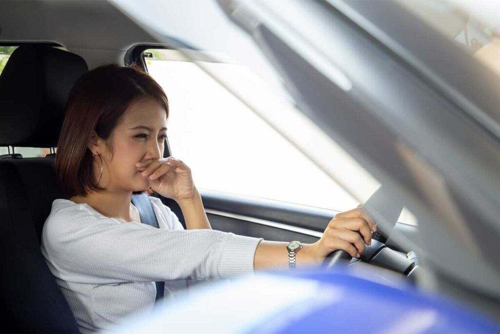 Person Holding Nose Because of Bad Smell in Car