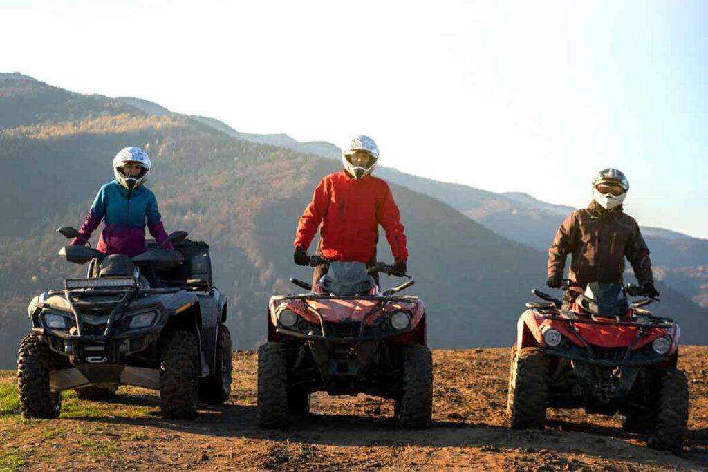 Three ATV Riders Off-Roading