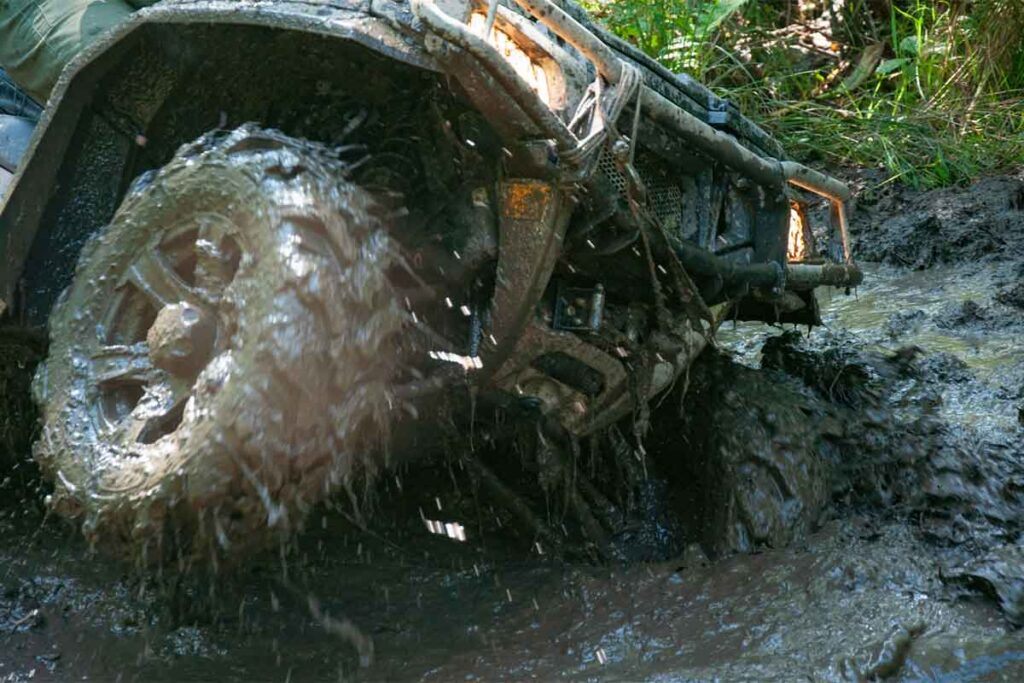 ATV Wheels in the Mud in a Difficult Section