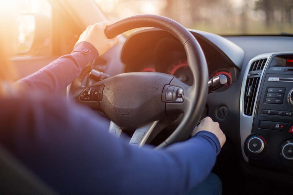 Person Starting Car and Turning Key Ignition