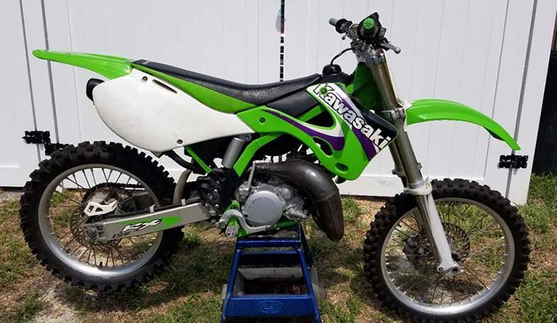 Green 1999 Kawasaki KX 125 Dirt Bike