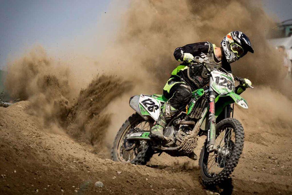Green Dirt Bike on Dirt Track