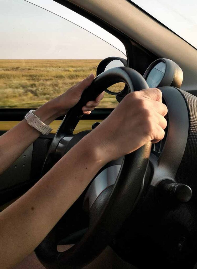 Person with White Watch Driving