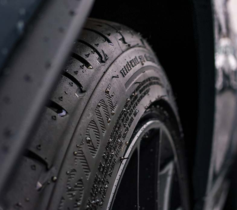 Rubber Tire Tread Sprinkled With Water Droplets